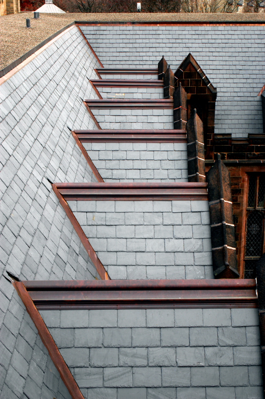 Picture of slate roofing and extensive copper work in all built-in gutters and flat seam pocket roofs at Princeton University�s Humanities Building